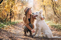 young-woman-park-with-her-white-dog_1303