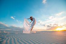 girl-fly-white-dress-dances-poses-sand-d
