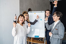 businesspeople-with-whiteboard-discussin