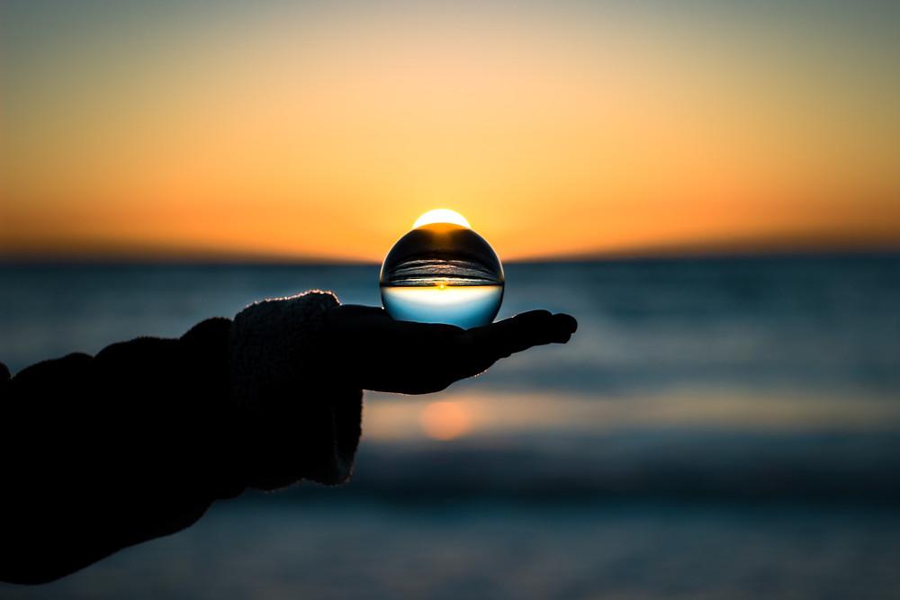 crystal ball against sunset