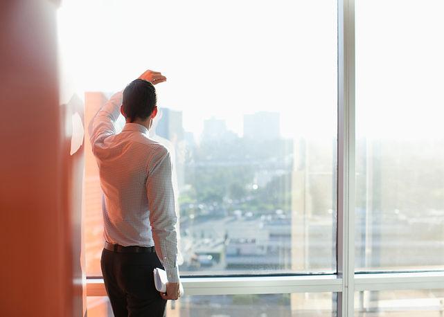 Man Looking Through a Window