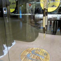 custom door handle and floor inlay