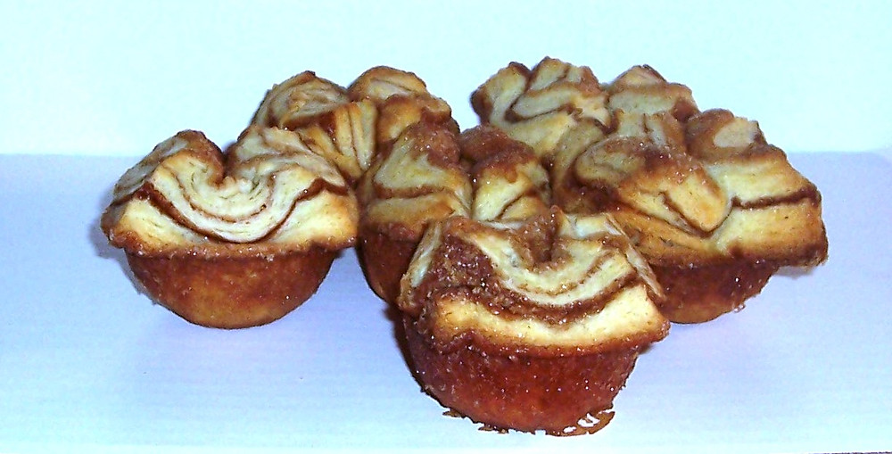 You can see the flaky layers from the lamination but you can also see how the sugar caramelizes on the outside