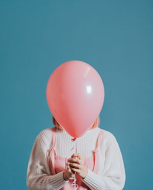 girl-with-a-pink-helium-balloon.jpg