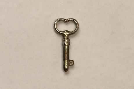 Round brass key