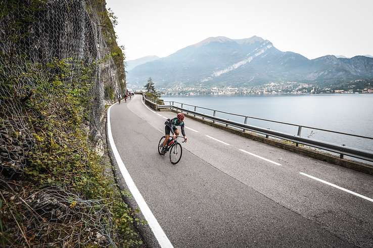 Cyclist with customized full carbon road bike at Como lake. Zeen bike, Italian vision with Swiss precision