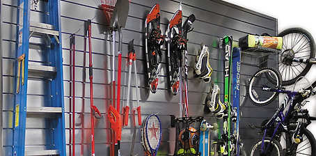 Slatwall Slat Wall holding garge tools and bikes