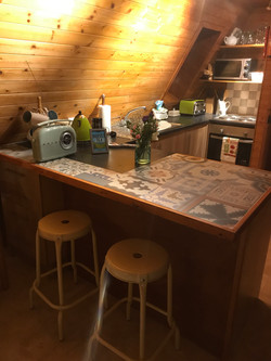 The kitchen and breakfast bar