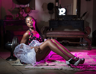 woman-sits-on-gray-textile-1442661.jpg