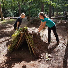 Ladies making a shelter.