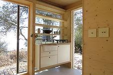 House On Wheels -tiny off-grid cabin's bespoke kitchen unit