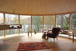 Am Falachan Roundhouse interior with view over Loch Broom