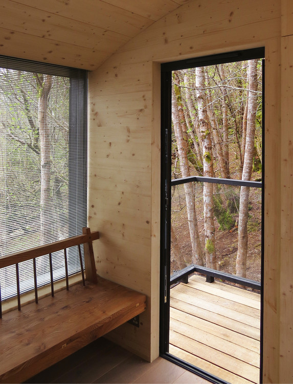 Tree Hoose Interior 7 - convertible window seat/ daybed  at door to balcony