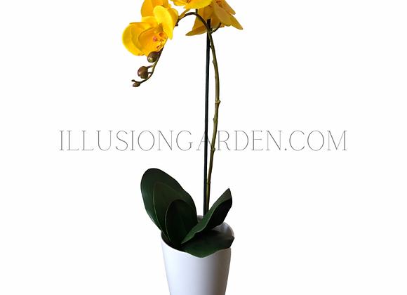 Orquídea artificial amarilla en maceta blanca