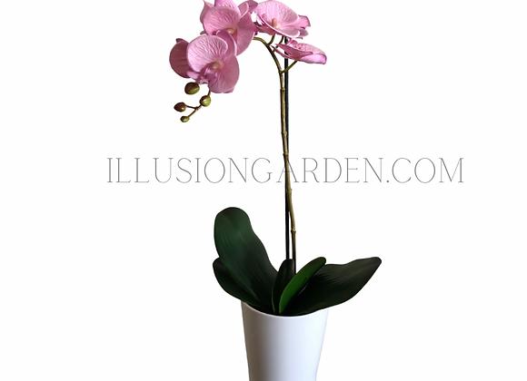 Orquídea artificial rosada en maceta blanca