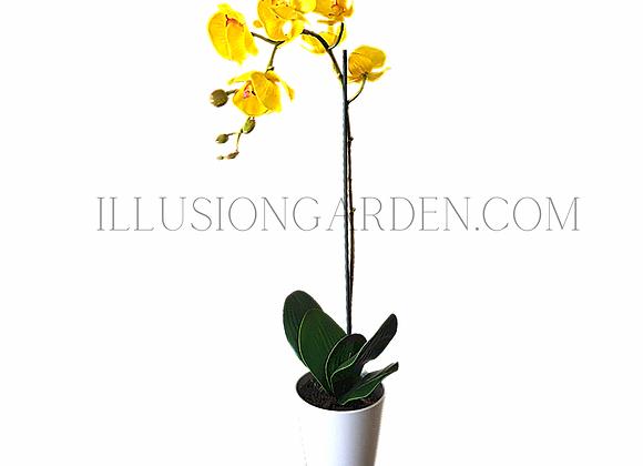 Orquídea artificial amarilla grande en maceta blanca