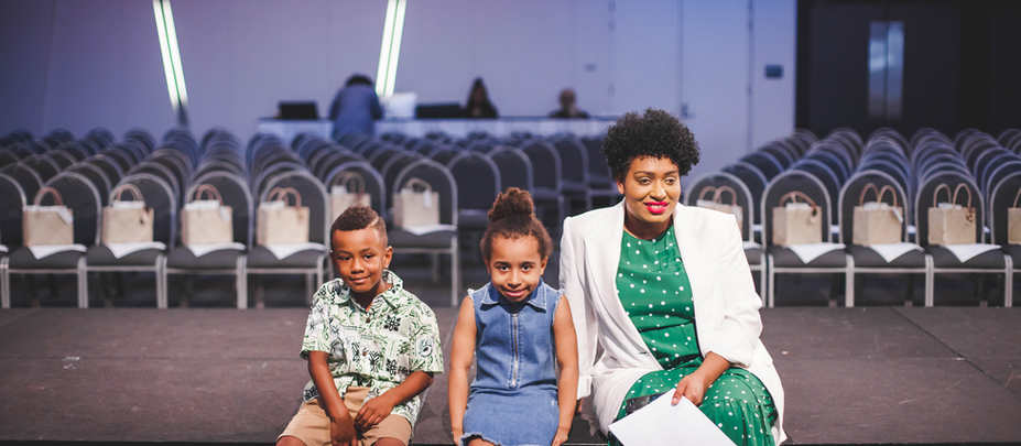 Cassaundra Rangip, Founder, with her daughter and children's models back stage