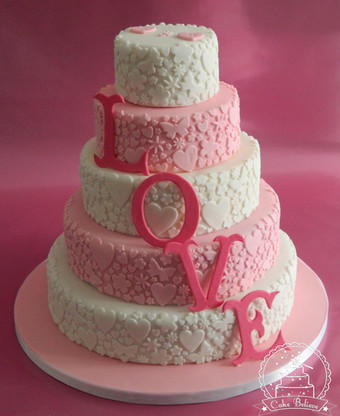 Pink and while 'Love' wedding cake
