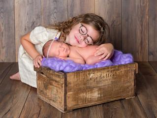 Newbornsessie met zusje