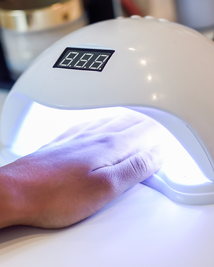 manicured-nails-uv-lamp-beauty-salon.png