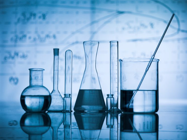 An assortment of glass lab equipment such as beakers and test tubes.