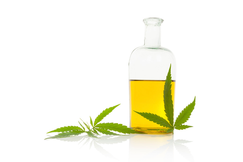 Clear and vibrant Hemp Seed Oil in a glass container.