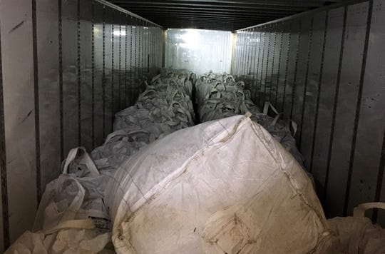 Hemp materials are baled in large sacs to be transported for processing.