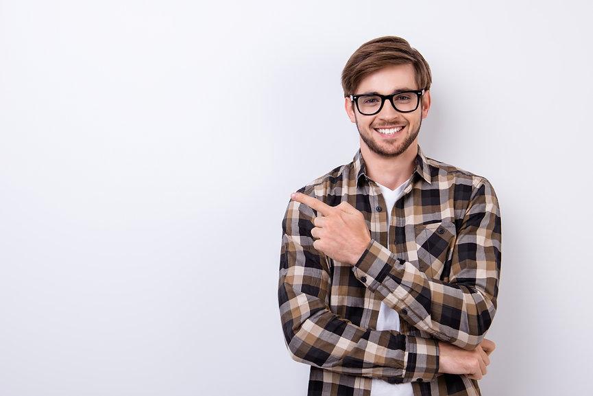 Smiling young nerdy bearded stylish stud