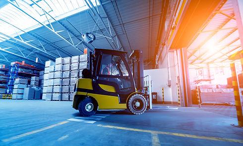 Forklift loader in storage warehouse ship yard. Distribution products. Delivery. Logistics