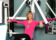 julie sitting on chest press.jpg
