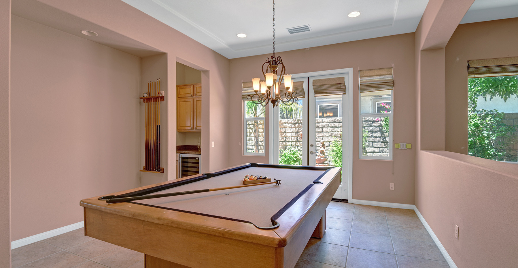 DINING ROOM SET UP WITH BILLARDS MLS.jpg