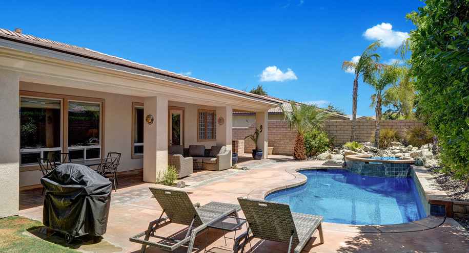CHAISES TO POOL AND BACK OF HOUSE MLS.jp