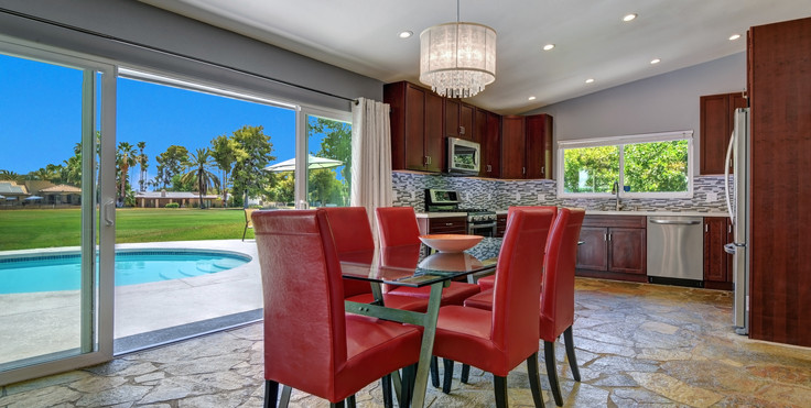 DINING ROOM TO KITCHEN AND POOL.jpg