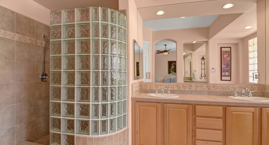 PRIMARY BATHROOM SHOWER AND VANITY MLS.j