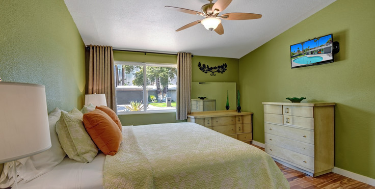 END GUEST BEDROOM ANGLED WITH TV.jpg