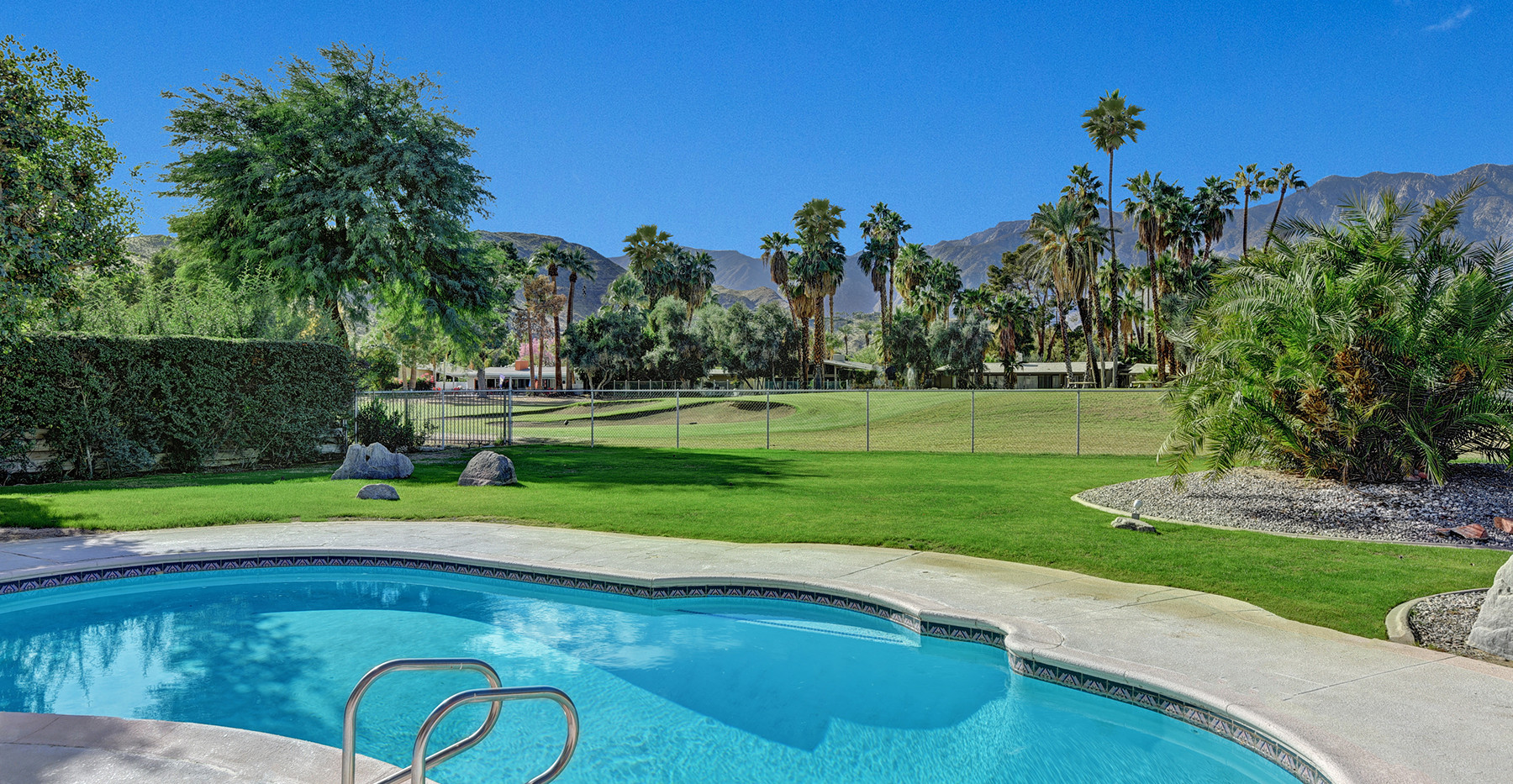 01-POOL TO FAIRWAY AND MOUNTAINS MLS.jpg