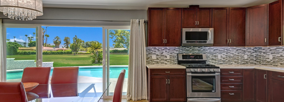 DINING ROOM AND KITCHEN ACROSS TO POOL.j
