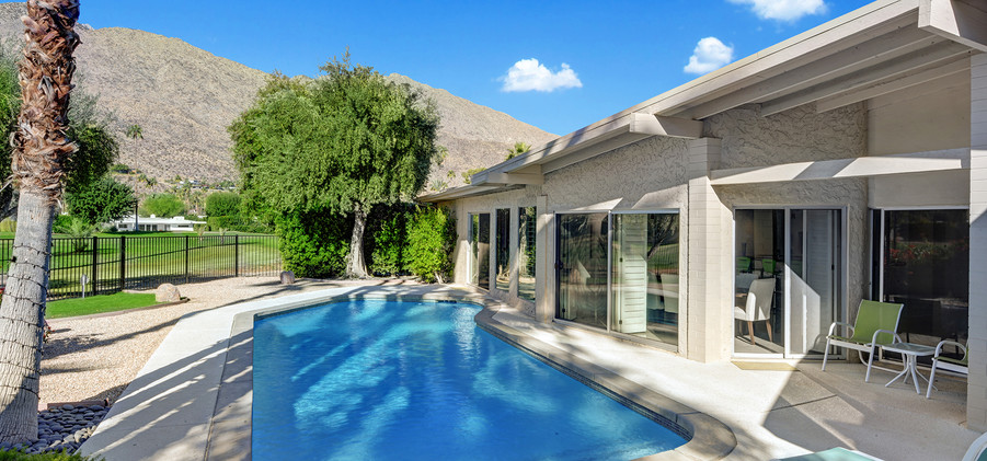 POOL TO BACK OF HOUSE AND MOUNTAINS MLS.