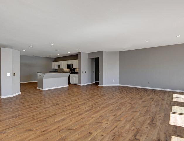 LIVING ROOM ANGLED TO KITCHEN MLS.jpg