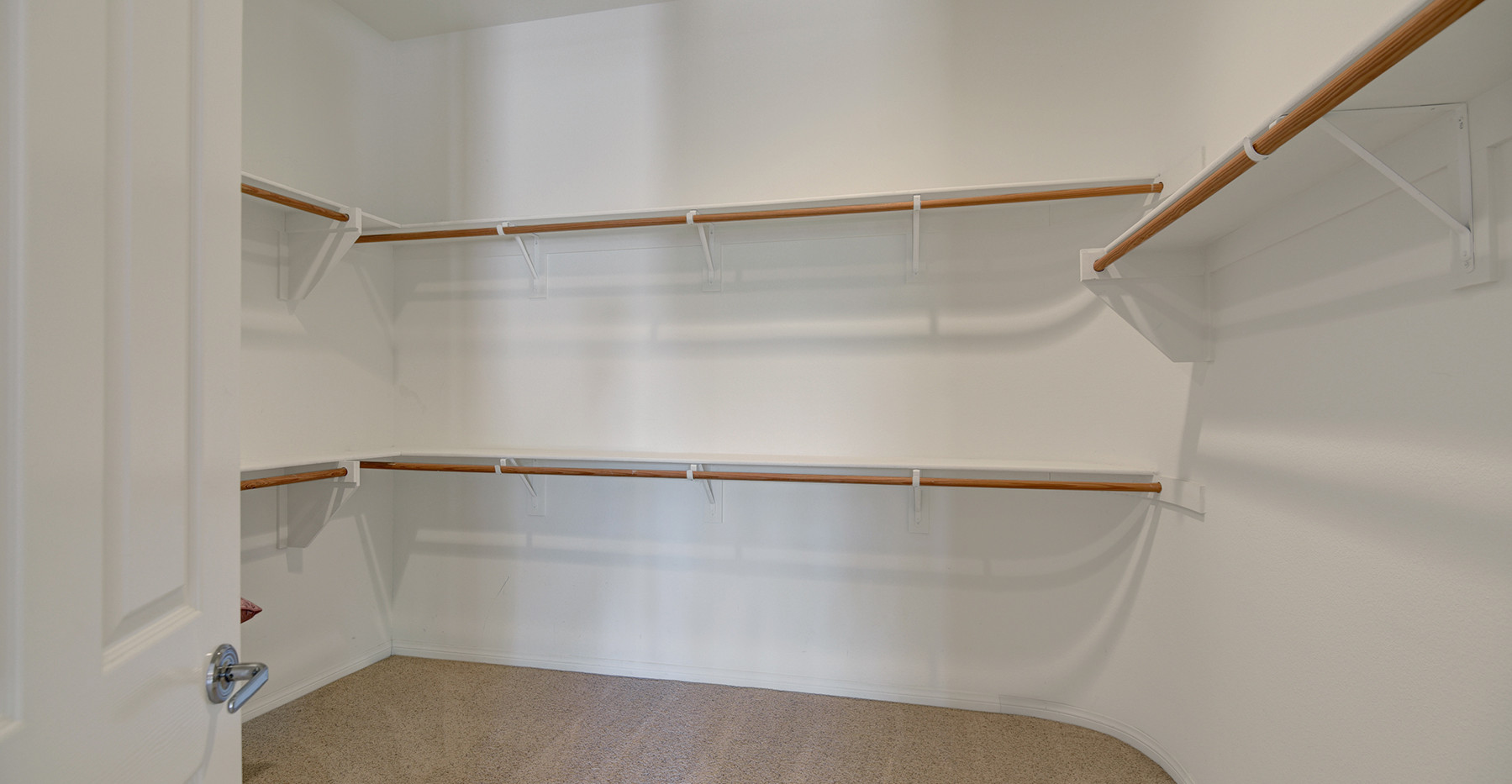 PRIMARY BEDROOM WALK IN CLOSET MLS.jpg