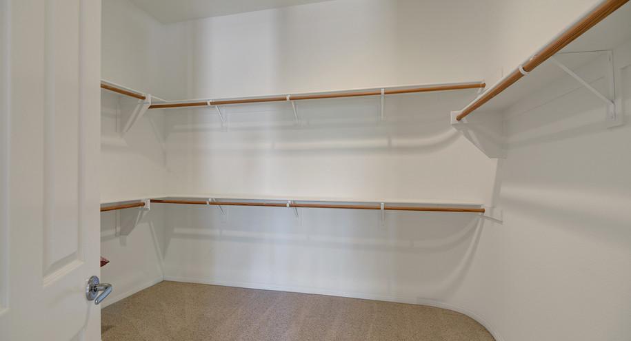 PRIMARY BEDROOM WALK IN CLOSET MLS.jpg