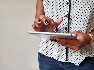 black-woman-holding-ipad-createherstock.