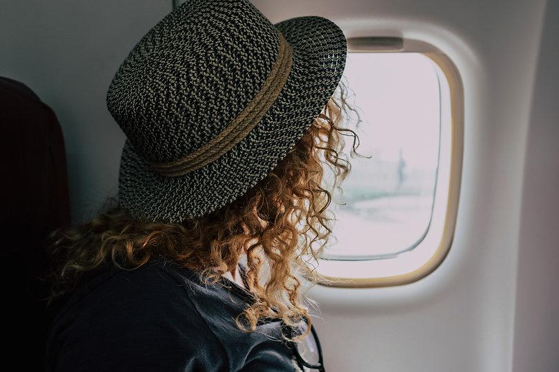 woman-travel-on-aircraft-flight-9QGH37S_