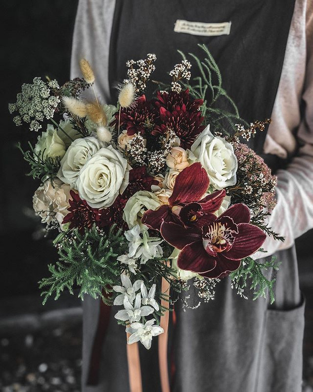 A wintery and moody bridal bouquet mock-