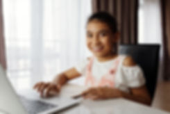 Canva - Young Girl Using a Laptop.jpg