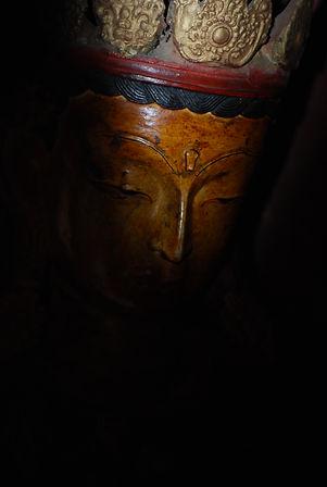Buddha statue in darkness.JPG