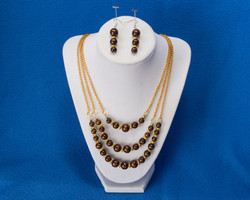 Brown beads on gold chain