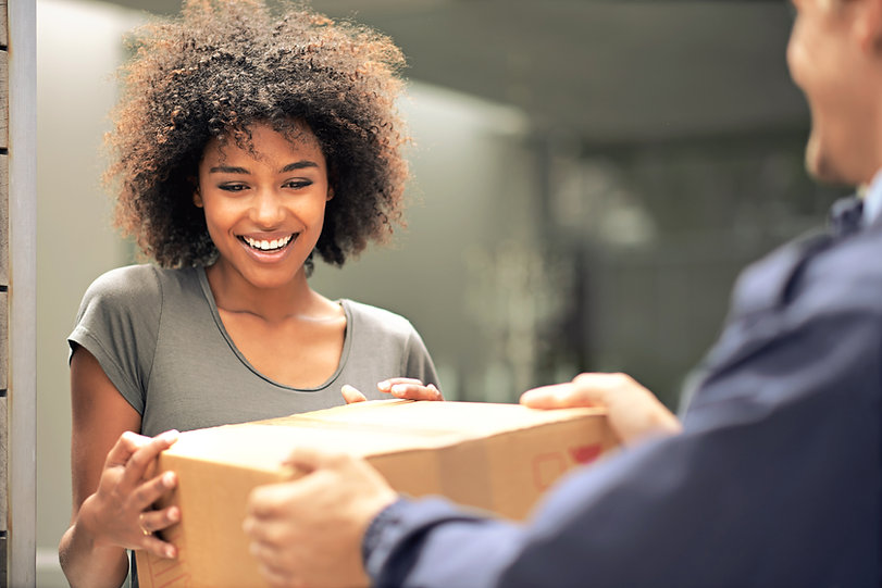 Woman Smiling at a package delivery