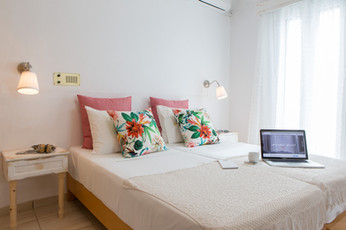 double bed,pillows with leaves