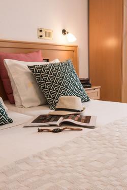 newspaper on bed, Artemis hotel
